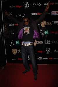 Durella dressed in the dark, it seems. Couldn't he copy D'banj's style