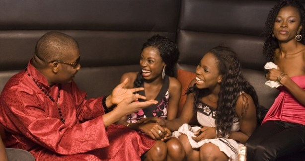 The girls with Don Jazzy, hanging on to his every word?