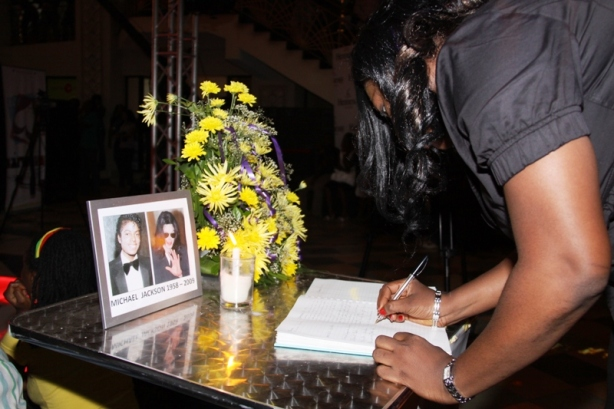 Signing the condolence register - Lots of people want to know if it'll be sent to the Jacksons. We think that's the plan